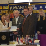 Chase Venable, President of the Downtown Kiwanis Club of Paducah presents a $500 check to Stacy Thomas, Coordinator of the Mustangs Youth Services Center.